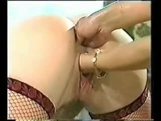 A fine double fisting for girl in fishnets