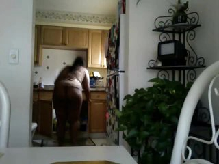 Black chick does the dishes in pants
