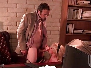 Sluty blond with huge hooters gives blowjob to nerdy hunk in office