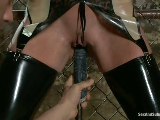 Felony gets bound to the fence and has a machine toy her til this babe cums
