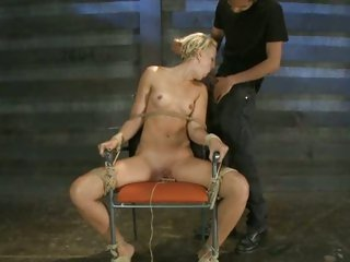 Bound whore Dylan Ryan gets a mouth full off cock