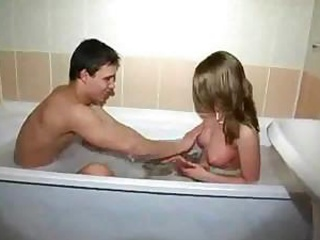 Young Couple Have Enjoyment In Bathroom
