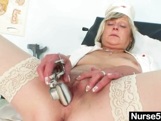 Indecent nurse milf Nada fucks herself with large vibrator