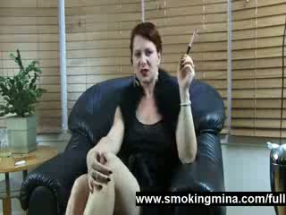 Smoking and stripping milf