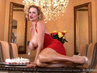 Kelly Madison has fun with her birthday cake on love melons