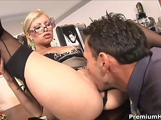 Long legged glassed office blonde Donna Bell in black nylons and high heels gets her hot pussy eaten and fucked on the desk by horny boss. This four-eyed dream babe loves hardcore sex at work!