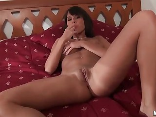 20 year old completely naked brunette Melanie Memphis strokes her hairless pussy in the middle of the bed. She opens her legs and gets the masturbation session started. Dildo is what she uses after her playful fingers.