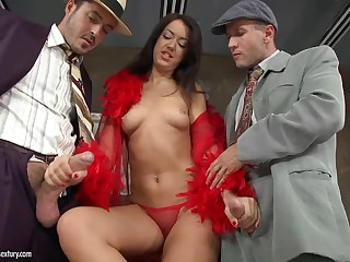 Two elegant gents from 20's can't resist the charm of brunette lady in red. They fuck Malaya at both ends before double penetration. She's in the middle of the sandwich as she gets double fucked standing up.