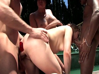Cock loving bitches fuck outside by a pool