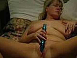 mature blonde chick masturbating with dildo