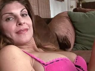 Elegant cougar Monique of Anilos.com masturbates on the couch