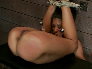 tied up skinny brunette moans with pleasure and pain