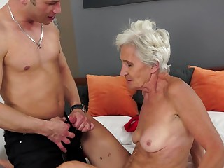A granny is getting her pussy hard to believe wide open by a young cock
