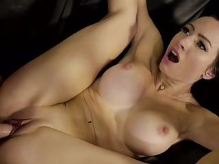 A slut with large fake boobs gets fucked in the intense video on the sofa