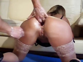 Double fisting her ass while that babe wears stockings