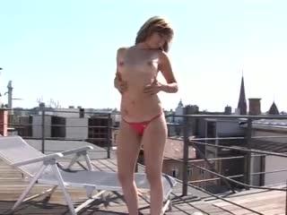 Teen on rooftop masturbates her pussy