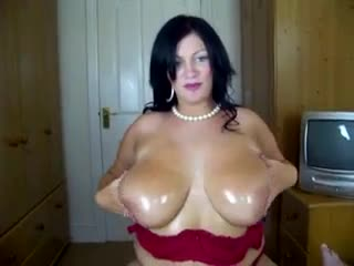 Sexy BBW strips erotically and gives a titjob